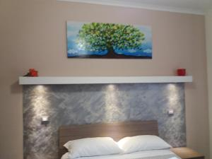 A bed or beds in a room at Casa Vacanze Lory