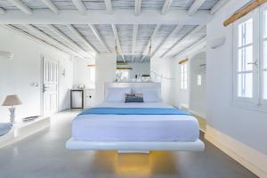 A bed or beds in a room at Evlalia Studios & Villas