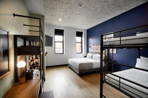 A bunk bed or bunk beds in a room at TRYP by Wyndham Pittsburgh/Lawrenceville
