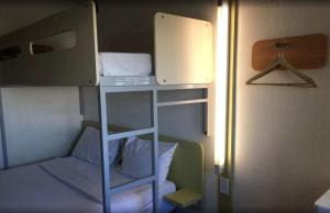 A bunk bed or bunk beds in a room at ibis Budget - Campbelltown