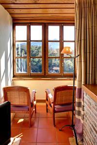Zona de estar de La Montaña Mágica Hotel Rural