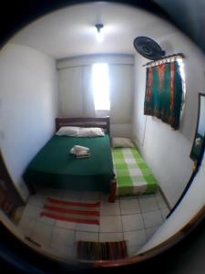 A bed or beds in a room at Chalice Hostel Rio Vermelho salvador