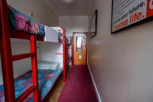 A bunk bed or bunk beds in a room at Royal Mile Backpackers