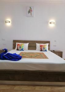A bed or beds in a room at Easy Stay Residence
