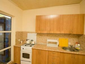 A kitchen or kitchenette at Вилла Соня