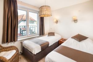 Een bed of bedden in een kamer bij Parkhotel