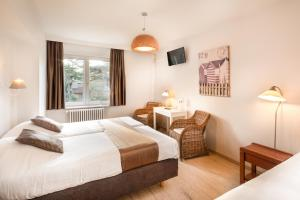 Ein Bett oder Betten in einem Zimmer der Unterkunft Parkhotel