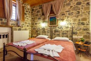 Ένα ή περισσότερα κρεβάτια σε δωμάτιο στο Δίκτυννα
