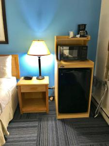 A bed or beds in a room at Baymont by Wyndham Marinette