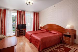 Кровать или кровати в номере Отель ИГМАН