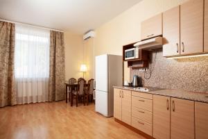 Кухня или мини-кухня в Отель ИГМАН
