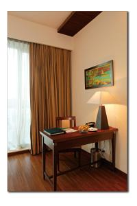 A television and/or entertainment center at Country Inn & Suites By Radisson - Amritsar