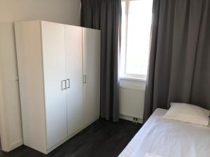 A bed or beds in a room at White Moon Apartment