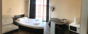 Кровать или кровати в номере Joy Apartments