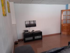A television and/or entertainment center at Primavera Miriam