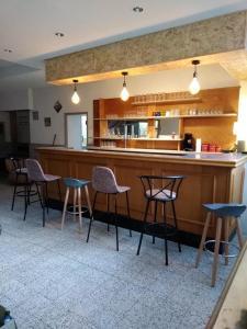 The lounge or bar area at Gite de la Gare