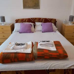 A bed or beds in a room at Apartmani stan na dan Tadić