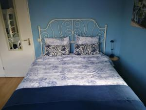 Een bed of bedden in een kamer bij B&B Le Bon Vivant Eindhoven