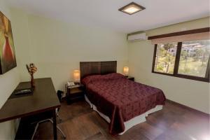 Een bed of bedden in een kamer bij Costa Brava Resort