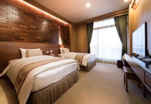 山多利大飯店房間的床
