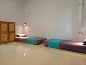 A bed or beds in a room at Sentul Hostel