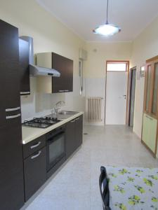 A kitchen or kitchenette at Lucia's apartaments