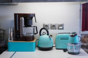 Coffee and tea-making facilities at Orianna Apartment Airport by Airstay