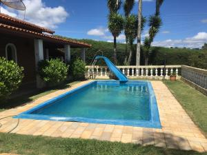 The swimming pool at or near Chácara São Francisco