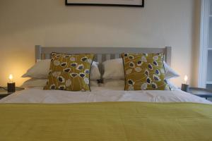 A bed or beds in a room at Willy Wallace Hostel