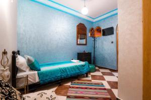 Un ou plusieurs lits dans un hébergement de l'établissement Riad Royal