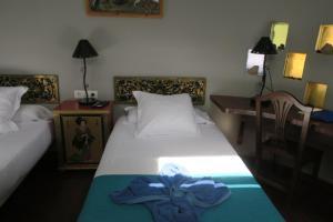 Een bed of bedden in een kamer bij Casa de Hilario