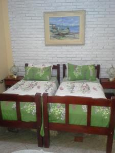 A bed or beds in a room at Chácara São Francisco
