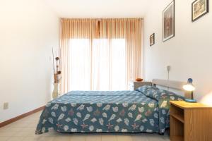Postel nebo postele na pokoji v ubytování villa Sayonara