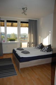 Postel nebo postele na pokoji v ubytování Apartament Bemowo Przestrzeń