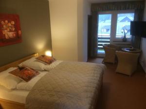 Ein Bett oder Betten in einem Zimmer der Unterkunft B&B Hotel Stadt Winterberg