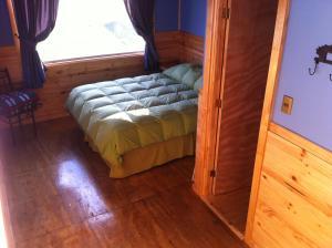 A bed or beds in a room at Vista al Paine - Refugio de Aventura