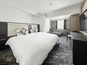 A bed or beds in a room at Cross Hotel Osaka
