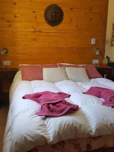 Una cama o camas en una habitación de Pa-kuas del Uritorco