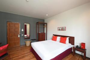 Ruamchitt Plaza Hotelにあるベッド