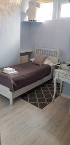 Łóżko lub łóżka w pokoju w obiekcie Hotel Mikołaj