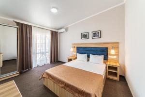 A bed or beds in a room at Democratia Ultra All Inclusive