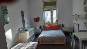 Łóżko lub łóżka w pokoju w obiekcie Master Corner Guest Rooms