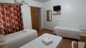 A bed or beds in a room at Hotel Pousada Sinos