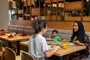 A restaurant or other place to eat at Hilton Garden Inn Dubai Mall Of The Emirates