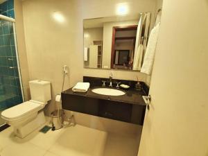 Um banheiro em Apartamento Barra Pé na Areia