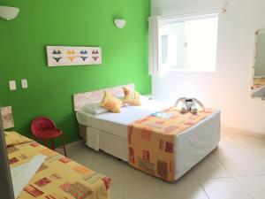 A bed or beds in a room at Pousada Baía das Conchas