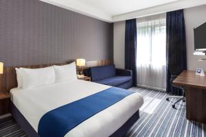 A bed or beds in a room at Holiday Inn Express Colchester