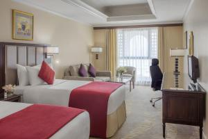 A bed or beds in a room at Dar Al Iman InterContinental