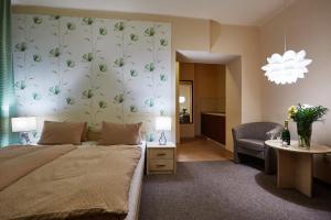 Postel nebo postele na pokoji v ubytování Hotel Slunce