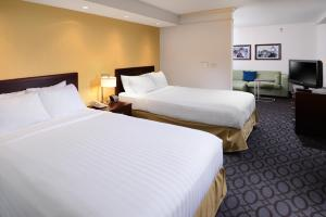 A bed or beds in a room at SpringHill Suites Fort Worth University
